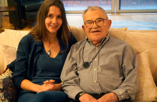 Lea Heitfeld and Ben Stern sit on the couch in their Berkeley apartment. Stern is a 95-year-old Holocaust survivor from Poland and Heitfeld is a 31-year-old German graduate student whose grandparents were active Nazis.