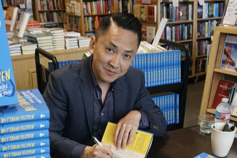 "Pulitzer Prize-winning author Viet Thanh Nguyen signs copies of his new collection of short stories, ""The Refugees."" Nguyen came to the United States with his family as a refugee from Vietnam after the end of the Vietnam War in 1975."