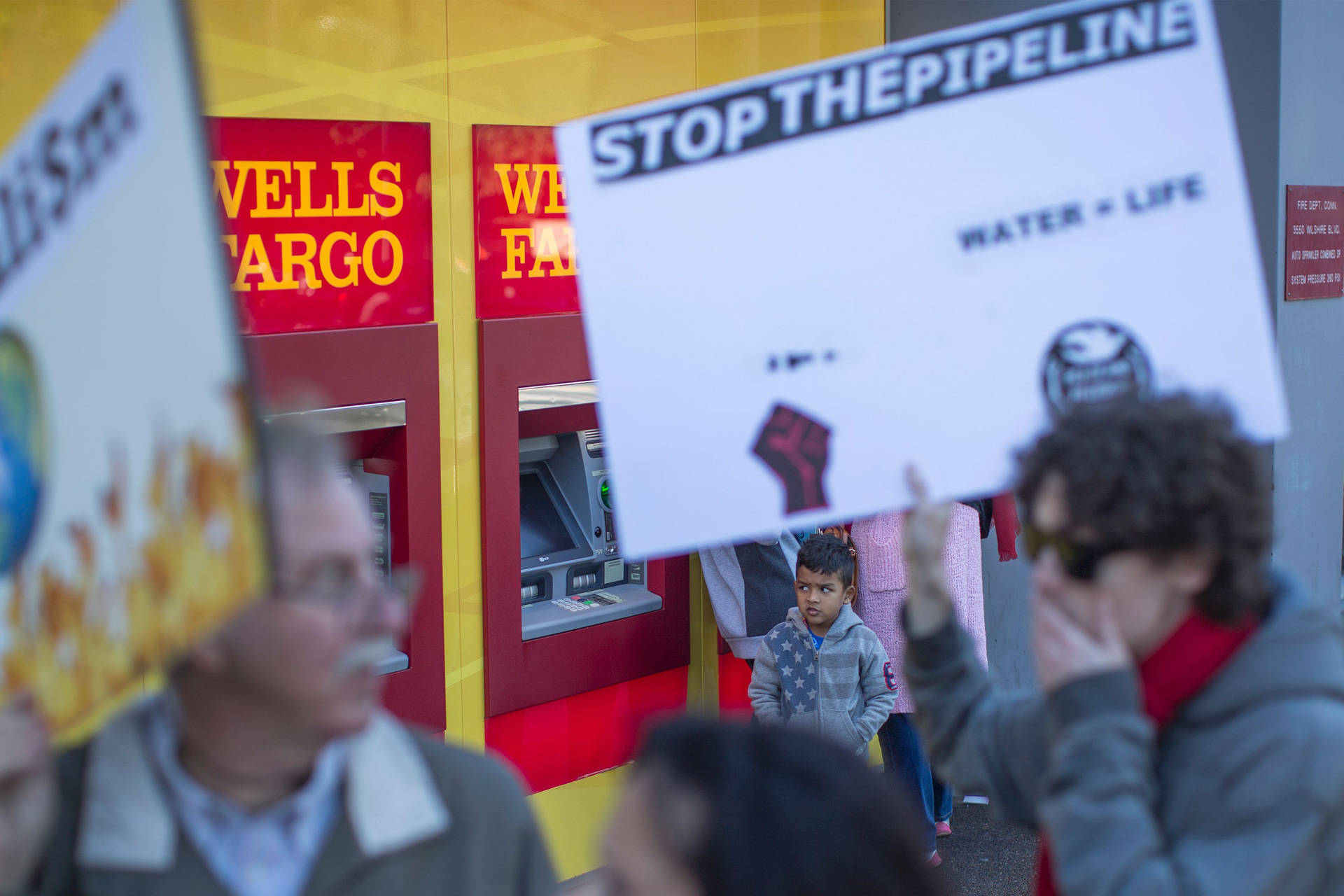 Supporters of the Standing Rock Water Protectors call on banks to divest from the Dakota Access Pipeline in a protest outside a Wells Fargo branch in Los Angeles on Dec. 16, 2016. David McNew/AFP/Getty Images
