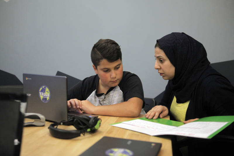 Zainab Salih (right) tutors Fadi Alaksan as part of the Yalla program.