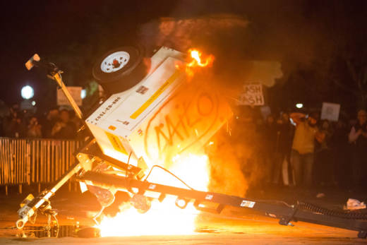 Protesters toppled a mobile spotlight and set it on fire during a demonstration against the scheduled appearance of Milo Yiannopoulos at UC Berkeley on Feb. 1, 2017. The event was canceled after demonstrators removed police barricades and occupied Sproul Plaza.