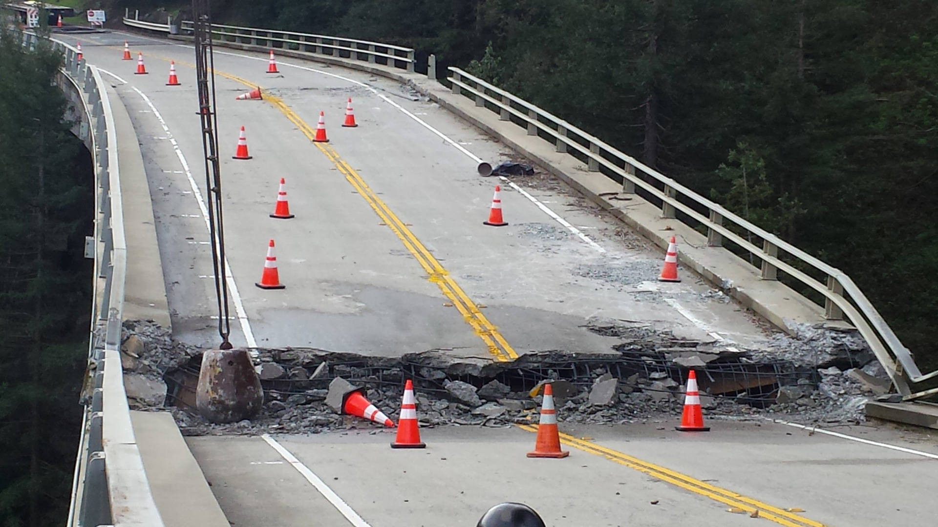 Demolition work takes place on the damaged Pfeiffer Canyon Bridge on March 16, 2017. Caltrans