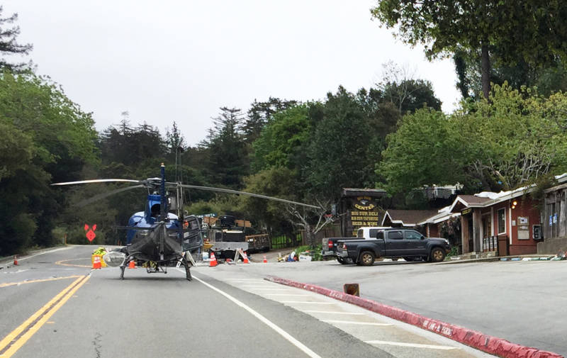 A helicopter sits on Highway 1. Since February, it's been one of the few ways in and out of the area south of the Pfeiffer Canyon Bridge.