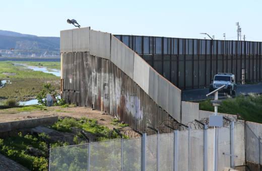 A Border Patrol vehicle sits along the U.S.-Mexico border wall on Jan. 25, 2017 in San Ysidro.
