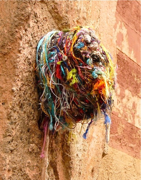 These colorful bundles of thread can be found on the walls of back alleys in Morocco in cities like Marrakesh and Fez.