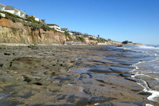 Bedrock is exposed at low tide along the beach at Isla Vista.