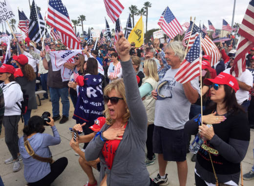 Marchers take part in a Pro-Trump rally on Saturday in Huntington Beach.