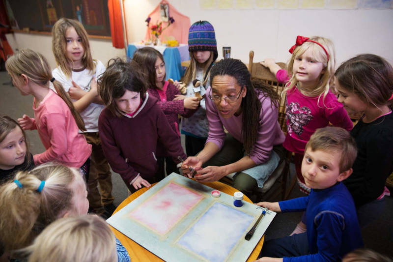 First grade teacher Michele Conyers teaches watercolor painting to her class at the Waldorf-inspired Stone Bridge School in Napa.