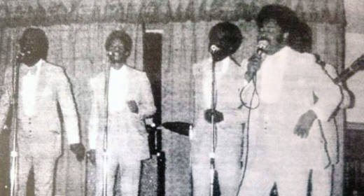 An archival photo of the Supreme Jubilees performing.