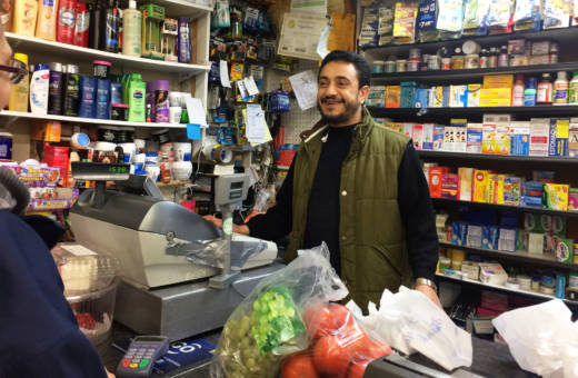 Mogeeb Alomri chats with customers at his grocery store in Oakland. Alomri believes President Trump's immigration orders could hurt his business and the likelihood his Yemeni wife and children can emigrate to the U.S.