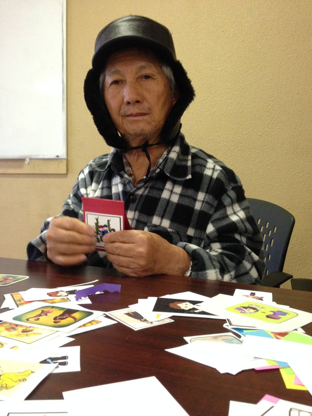 Vong Vang Xiong fought in Laos for six years in the CIA's Secret War. He does group crafts to help deal with depression.