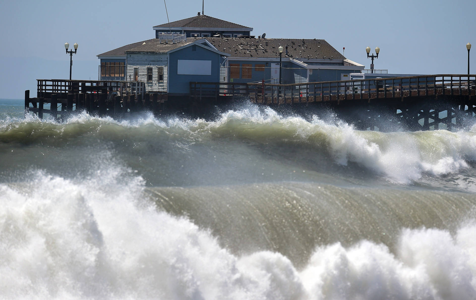 Large waves crash ashore and into the pier at Seal Beach in 2014. FREDERIC J. BROWN/AFP/Getty Images