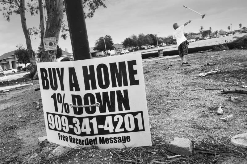 A sign lashed to street post across from Dream Street beckons would be home buyers with a seemingly irresistible offer.