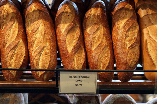 Freshly baked loaves of sourdough bread are displayed at Boudin Bakery.