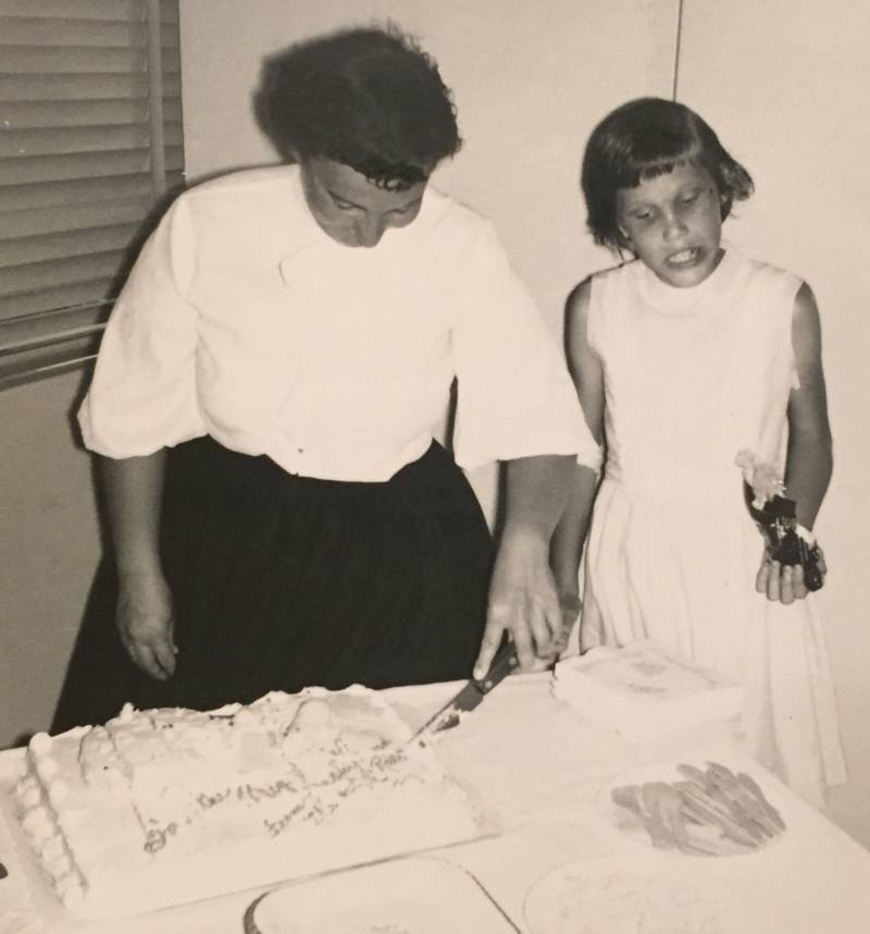 Nancy, after beginning treatment with Gary Fisher, cutting cake at a birthday party.
