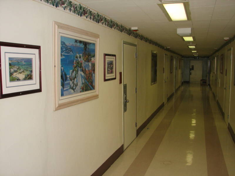 Recent photo of a hallway in Fairview Developmental Center.