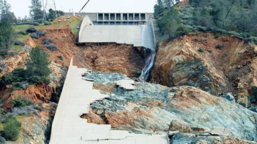 "Ruins of the main spillway at Oroville Dam reveal a blend of ""fresh"" (blue-gray) rock and ""weahered"" (reddish-brown) rock underneath."