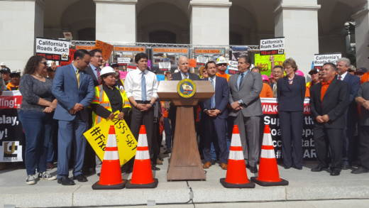 Governor Jerry Brown speaks at a rally in favor of a $52.4 billion transportation funding plan.