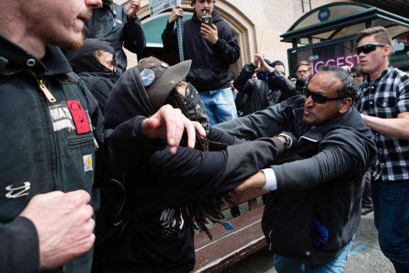 Trump supporters and counter-protesters fight on Shattuck Avenue in Berkeley on April 15, 2017. Police arrested at least 21 and said 11 were injured.