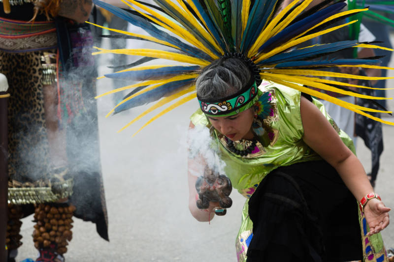 Sandra, who declined to give her last name, is a member of traditional dance troupe Xiuhcoatl Danza Azteca. They performed before a press conference in front of San Francisco City Hall on April 24, 2017 that was organized by members of the May 1st Coalition, who were announcing their participation in the upcoming May Day protest.