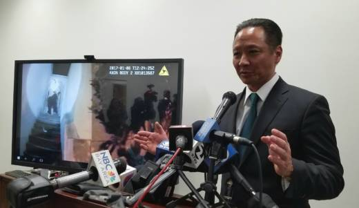 San Francisco Public Defender Jeff Adachi shows police body-camera video at a Jan. 18 press conference. Adachi released video of an SFPD officer shooting Sean Moore hours before the Police Department.