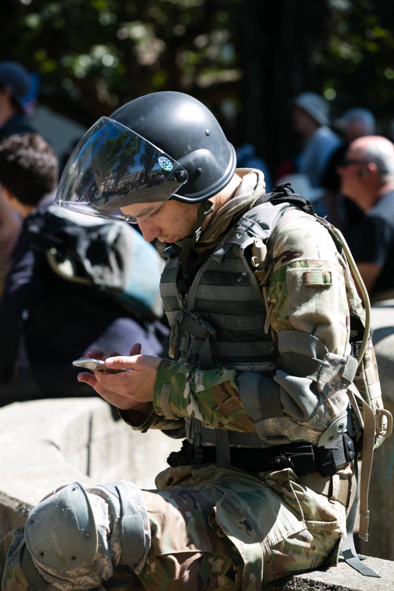 Owen Martinelli of San Rafael checked his phone during a conservative rally at Martin Luther King, Jr. Civic Center Park in Berkeley on April 27, 2017. Protesters originally planned to support an appearance by Ann Coulter at UC Berkeley, but when her event was canceled they held an event anyway.