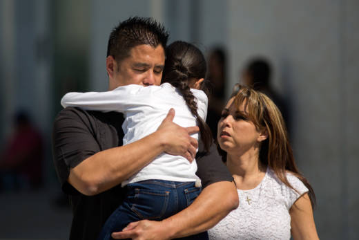 North Park Elementary School students and parents are reunited after a shooting at their school on April 10, 2017 in San Bernardino.