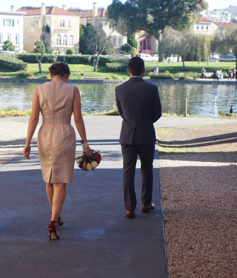 Olivia and Jacob walk together after their civil ceremony at the Palace of Fine Arts in December 2016.