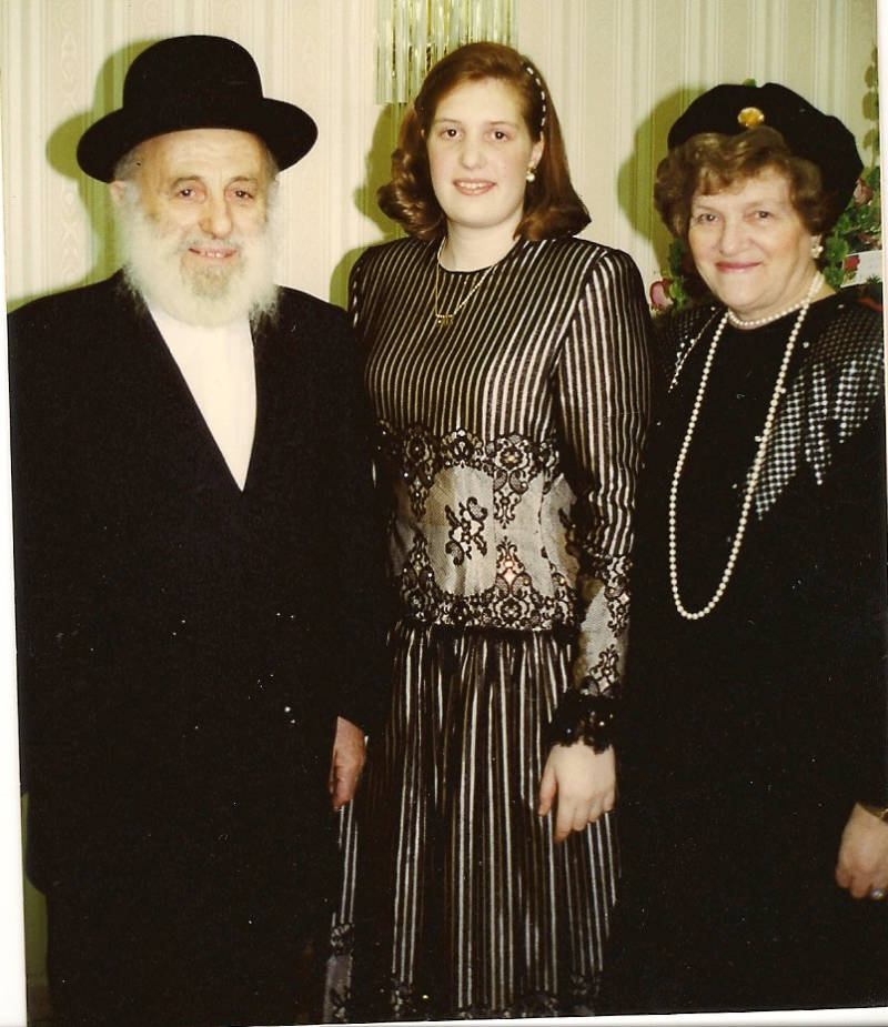 Henny Kupferstein, age 18, with her paternal grandparents on her engagement day.