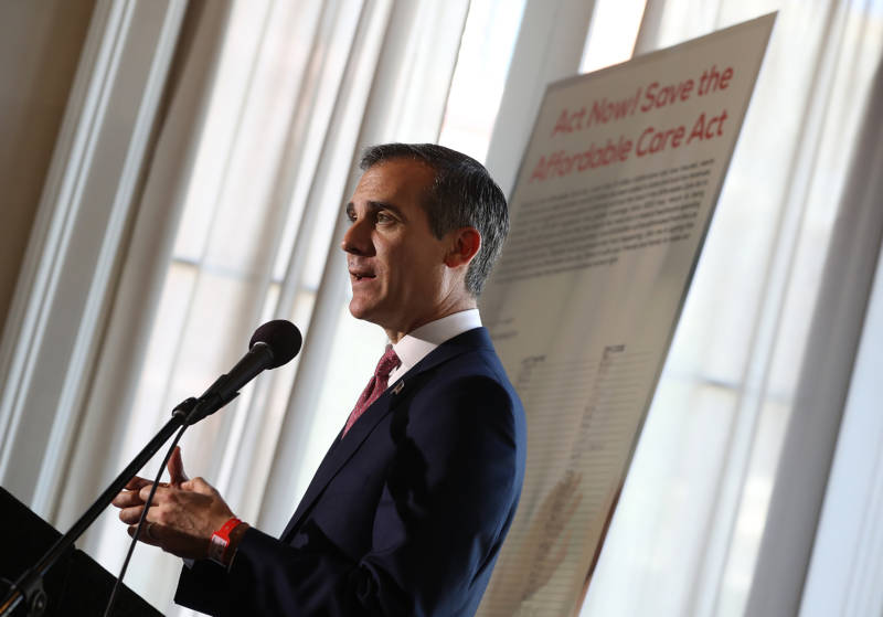 Los Angeles Mayor Eric Garcetti speaks during a town hall on the Affordable Care Act in Los Angeles on Feb. 22. Garcetti said he's trying to quell fears stoked in the city's immigrant communities by President Trump's calls for more cooperation between local law enforcement and federal immigration authorities.