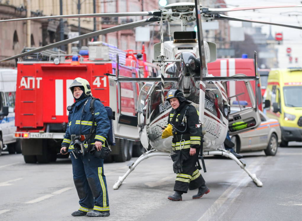 Rescue workers near the scene of the explosion on Monday in St. Petersburg, Russia.