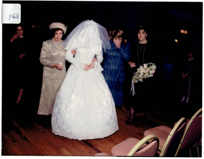Henny Kupferstein concealed by her veil on her wedding day.