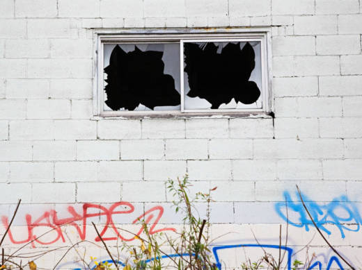The 'broken windows' theory of policing suggested that cleaning up the visible signs of disorder — like graffiti, loitering, panhandling and prostitution — would prevent more serious crime.