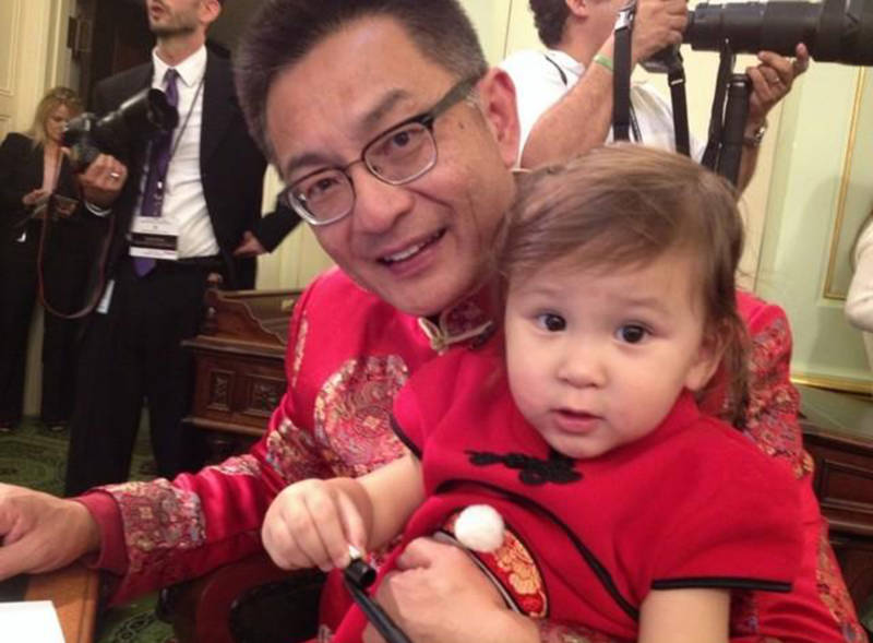 Asm. Kansen Chu with his granddaughter Kimberly at a swearing in ceremony.