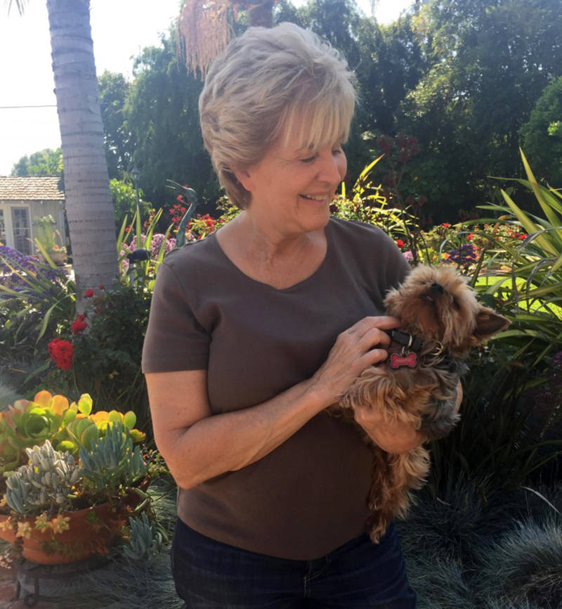 Donna Perez with her pet Yorkie, Cody. Her other dog was killed by a coyote in her backyard last fall.