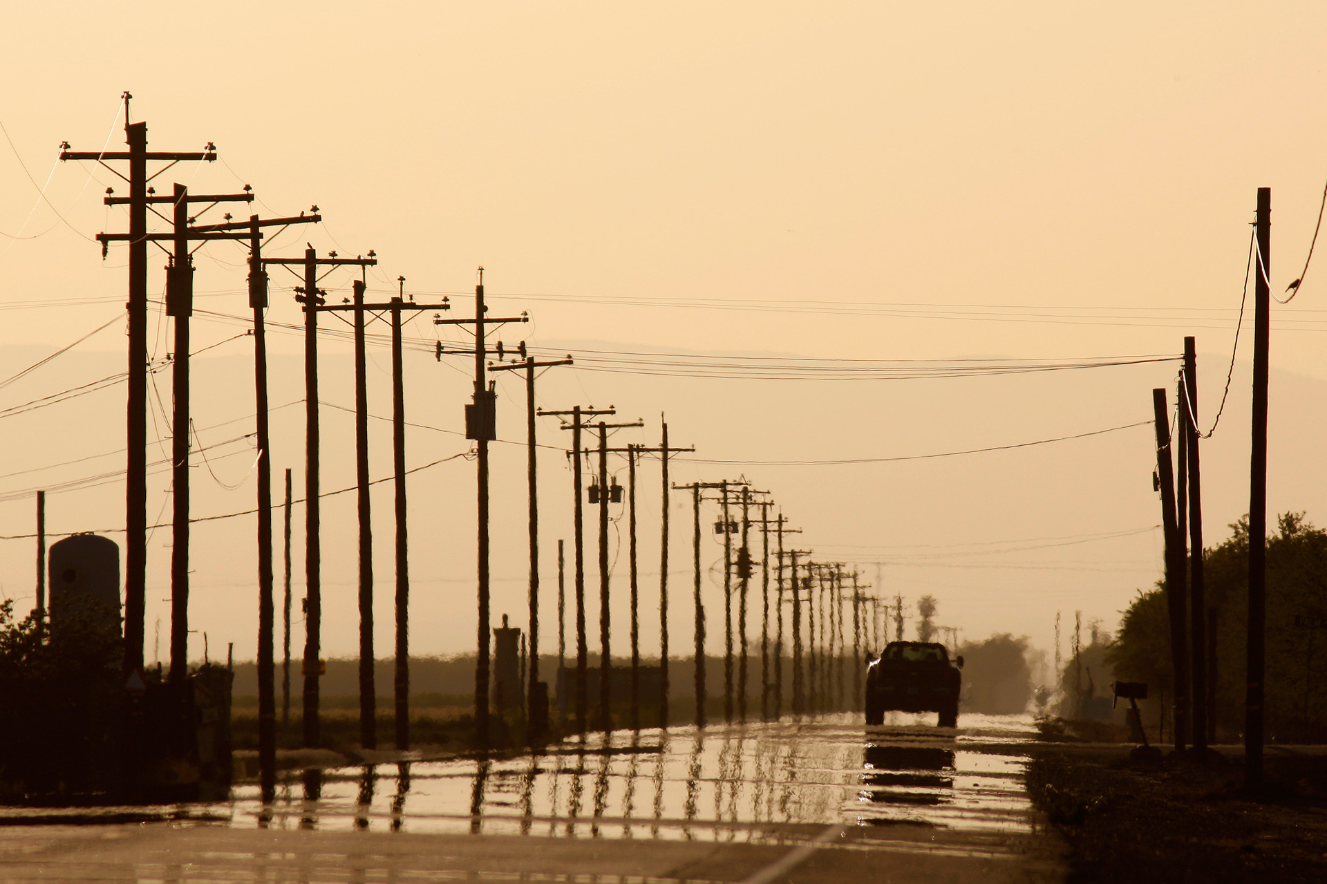 Haze hangs over a road close to I-5 near Buttonwillow, in Kern County.