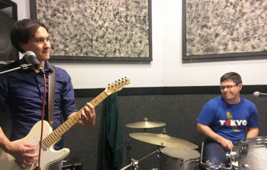 Lead guitarist Josh Fleury and drummer Rick Chapman jam during a late-night rehearsal.