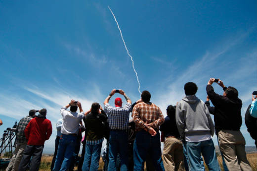 People watch a ground-based interceptor missile launch at Vandenberg Air Force base on May 30, 2017.