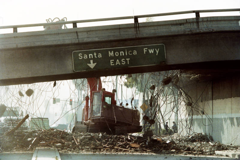 A bulldozer tears down a section of the Santa Monica Freeway that collapsed during the Northridge earthquake in 1994.