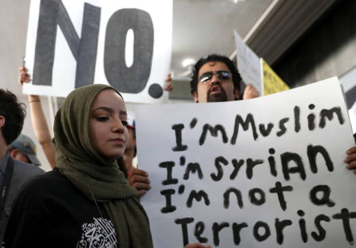 Protesters at LAX days after President Donald Trump issued a travel ban on people from several majority-Muslim countries.