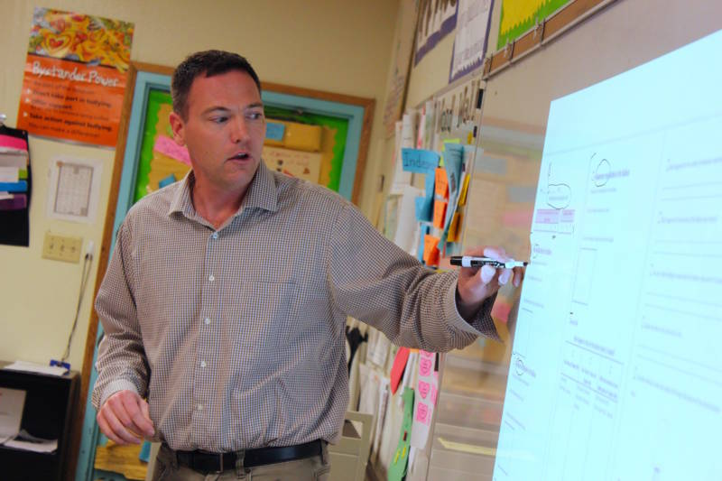 Andrew Osterhaus, a teacher at Ánimo Florence-Firestone Middle School in South Los Angeles, introduces a lesson in his science class. The campus is operated by Green Dot Public Schools, the leading charter school operator in L.A.