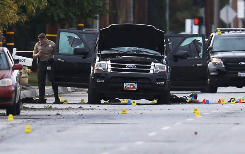Investigators survey the SUV driven by Syed Farook and Tashfeen Malik after their Dec. 2, 2015, attack in San Bernardino.