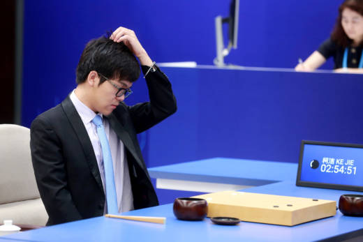 The world's top-ranked Go player, China's 19-year-old Ke Jie, reacts during the first of three matches against Google's artificial intelligence program AlphaGo on May 23. Ke Jie lost the match.