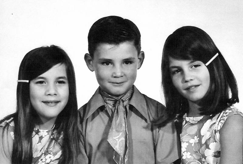 Cassie Riley (right) pictured at age 13 with her siblings.