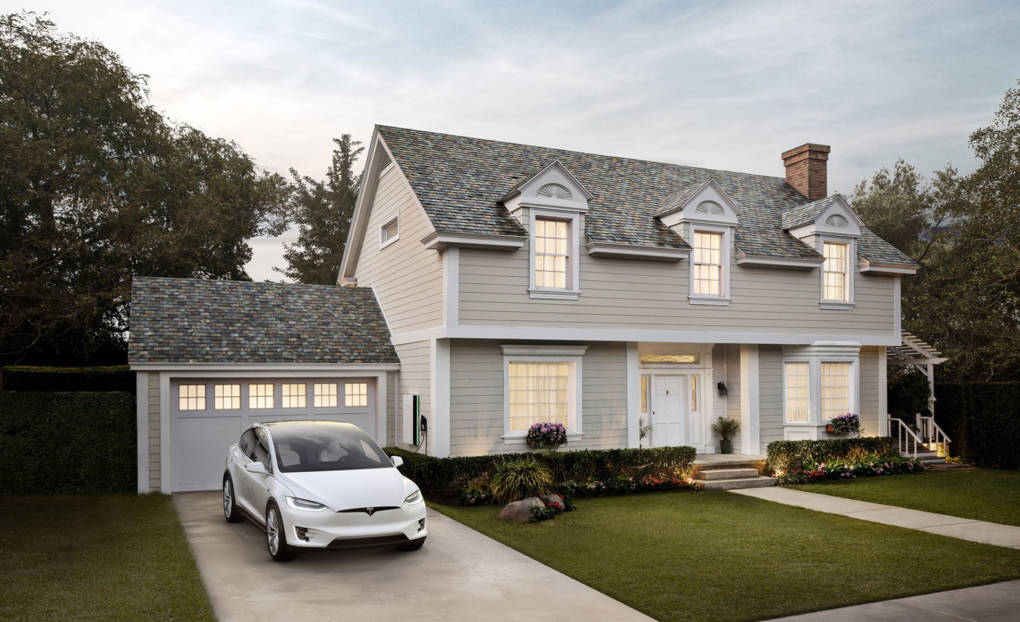 Tesla's new glass-covered solar roof tiles are designed to look like a traditional roof, doing away with the need for separate solar panels.
