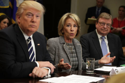 Education Secretary Betsy DeVos (C) and President Trump attend a parent-teacher conference listening session at the White House on Feb. 14, 2017.