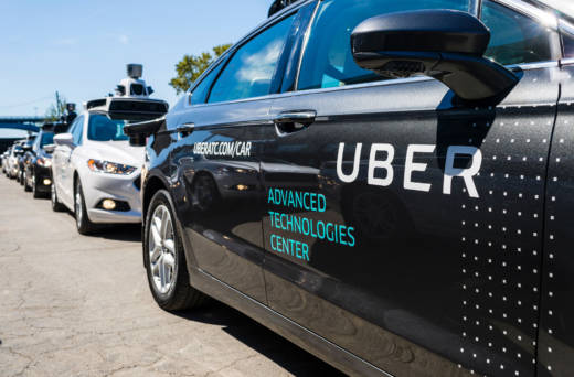 Pilot models of Uber's self-driving car on display in Sept., 2016.