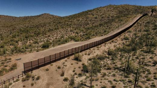 The metal fence along the border between Sonoyta, Mexico, and the Arizona desert in the United States.