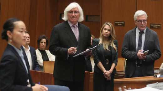 Model Dani Mathers listens as prosecutor Chadd Kim speaks at Wednesday's sentencing hearing. Mathers pleaded no contest to invading a woman's privacy in a gym.