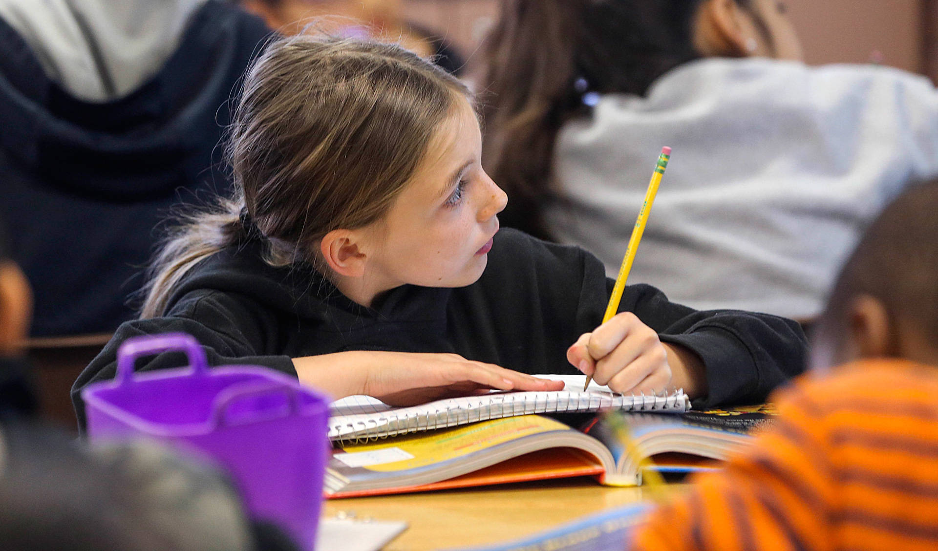 A Greenfield Union student takes notes during class at Kendrick Elementary School in Bakersfield. The district is one of 15 CALmatters studied to understand how well the state's new school funding formula is working. Henry Barrios/The Californian